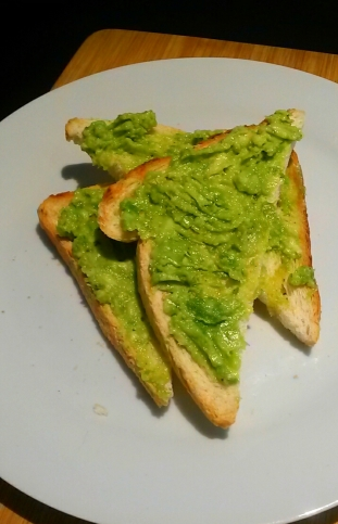 Toast coated with avocado
